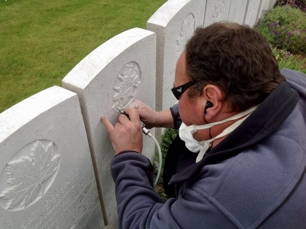 Etching the gravestones at Lijssenthoek